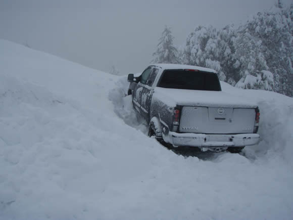 CJ Bartholomew's truck was one of several vehicles caught in this morning's snow slide on Highway 18.