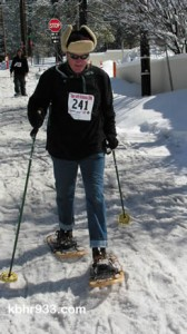 Jim Dooley of Fawnskin completes the race in his old school wooden snowwhoes.