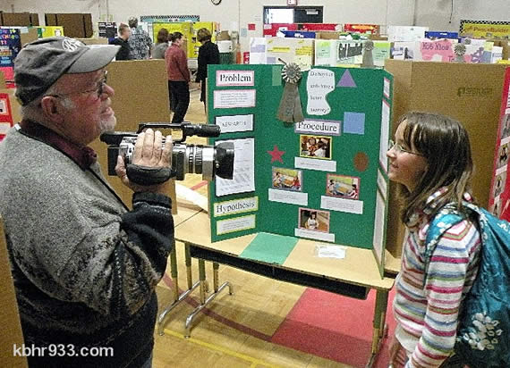Sixth grader Elizabeth Herrick, who took first place in the BBES science fair, is interviewed by Channel 6's Ron Seymour.