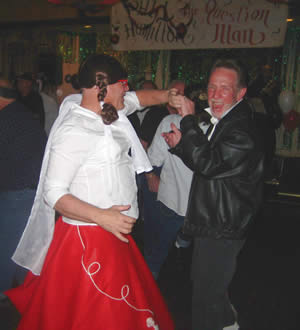 See how much fun you can have at a MAT event? Here, candidates Phil Hamilton (left) and Ace Evers enjoy a spin on the dance floor during Hamilton's sock hop at the Elks Lodge.