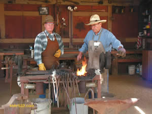 The museum's blacksmith shop is manned by volunteers Don Schaub and Arizona Al.