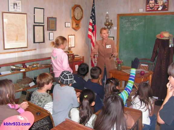 Museum curator Kim Sweet leads a field trip in the Mt. Doble schoolhouse, which was used in the Big Bear Valley as early as 1901.