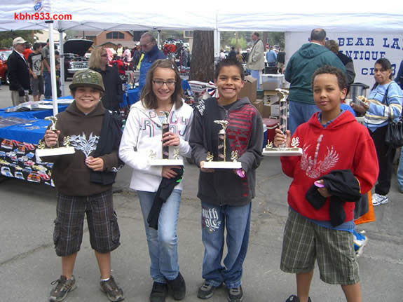 Baldwin Lane raced past the competition in last year's Pinewood Derby. Former 5th graders (from left) Daniel Bornia, who took 4th as a stand-in for buddy Klayton Planz, Mariah Baldwin took 2nd overall, Nickolas Rubio raced to 3rd, and Tyler Johnson brought the trophy home to BLES with his 1st place win. North Shore Elementary won in 2007, Big Bear Elementary in 2006.
