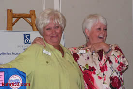 Twice as nice: Helen Walsh is joined at the podium by Dottie Suhr, disproving that the look-alikes are one Soroptimist