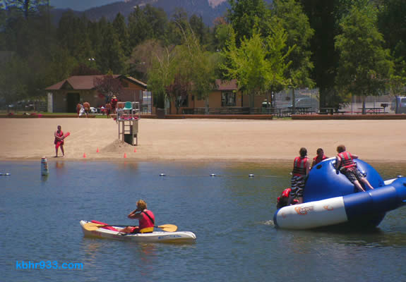 Swim Beach (captured here in a prior summer) now includes the Summit Slide and a trampoline, both on the water!