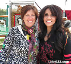Big Bear Choppers' Mona Alsop (right) made a visit to local artist Jeannie Houston Antes' booth displaying her vibrant and funky mosaics.