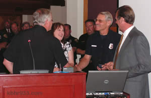 BBL Fire's Lance Swafford gets a congratulatory handshake from new Chief Rod Ballard, while wife Eileen, Assistant Chief Mark Mills and Mayor Herrick look on.