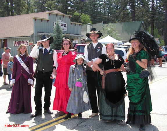 Returning Miss Clementine Keli Homan (at left) and Old Miners'-attired friends made their way to the Loggers Jubilee after the parade.