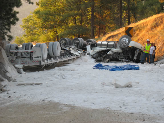This overturned truck resulted in a 13-hour closure of Highway 330.