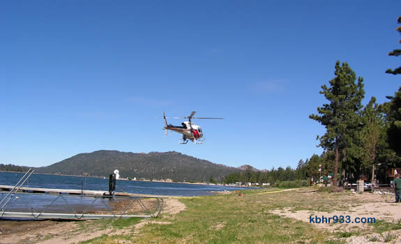 "The San Bernardino County Sheriff's Department helicopter, ""40 King,"" arriving on Big Bear Lake's North Shore, just east of the observatory and in front of the Big Bear Shores RV Park. This is the helicopter that transported the Sheriff's Department diving team, which assisted in the recovery."