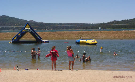Swim Beach has the 16' Summit Slide, new this summer, and a white sandy beach along Big Bear Lake.