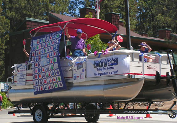 "The DOVES float, in Sunday's Old Miners' Days parade, showcased their ""Hands Are Not for Hitting"" quilt, using handprints from local elementary students and crafted by the Busy Bears Quilt Guild."