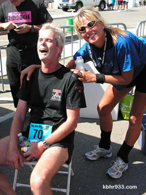 Doug Heyes, cheered on here by Diane Bradley (and all others at the finish line), recovered from paralysis to run a marathon--and plans to rejoin the Snow Summit Ski Patrol this season.
