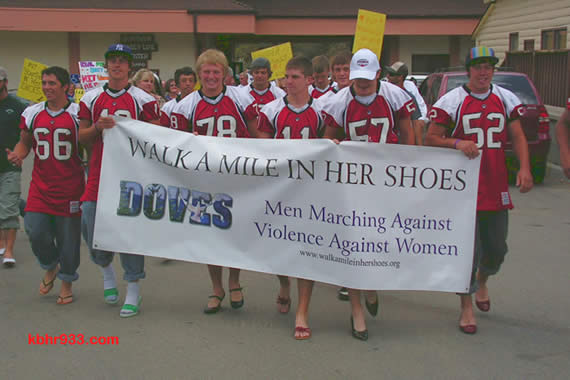 "The Big Bear High School Bears of the varsity football team led the 2008 ""Walk a Mile in Her Shoes"" march through the Village, which included 75 men in heels."