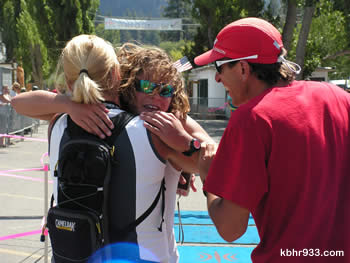 Thirteen-year-old Jordan Romero, the youngest to compete in the marathon, is embraced by parents LeighAnne and Paul at the finish line.