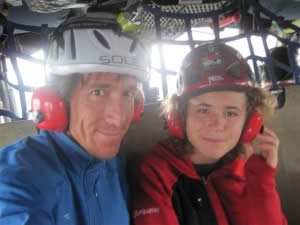 Paul and Jordan Romero on a helicopter en route to a base camp in Indonesia, for their September 2009 climb to the summit of Carstensz Pyramid.