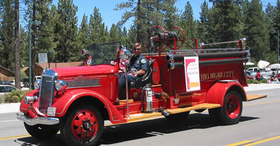 The Big Bear City Fire Department's original firetruck, a 1936 REO (here, driven by Captain Dave Delay), will be on display at Saturday's Open House.