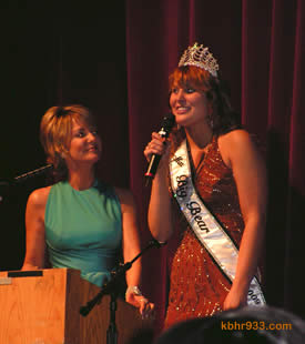 Outgoing Miss Big Bear Hayley Bracken, here with emcee Barbara Bayer-Coulter, noted that delivering Christmas gifts to a family in need was among her most rewarding experiences during her reign.