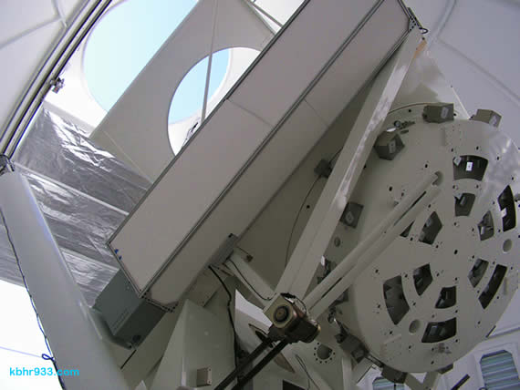 Because the telescope is so big relative to the size of the observatory's dome, it is difficult to pull back far enough to get a complete photo of the apparatus. The 1.6 meter mirror is housed in the round component to the right. The telescope turns on an axis parallel to the axis of the earth, and also changes position seasonally.