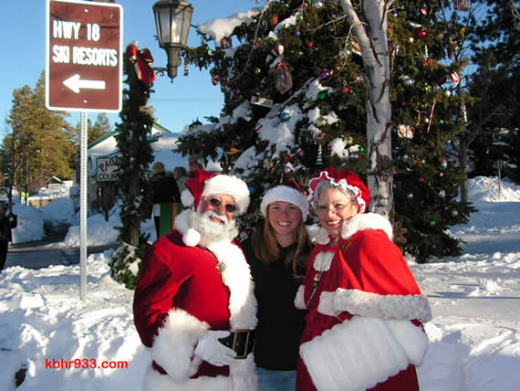 Santa and Mrs. Claus, during a sunny, post-snow day last December, with Old Miners' Days' Miss Clementine (for 2008 and 2009) Keli Homan at the Village's Christmas tree corner.