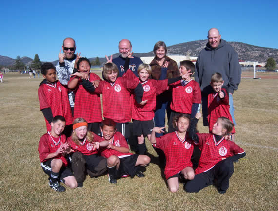 Team Takin' Care of Business did just that this season, going undefeated. The team (in their sillier photo, which we thought was more fun) from front left: Lathan Egerer, Drayden Gardner, Omar Pacheco, Haley Flanders, Emma Melissa, (middle row) Kameron Seay, Sebastain Millan, Hunter Francis, Xander Witt, David Leong, Garrett Hutcherson, (back) Coach Chase Gardner, John and Ginny Stock of Stock's Automotive, Coach Steve Egerer. (Photo, IDs courtesy of TCB)
