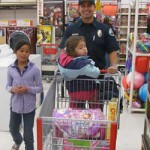 Local Firefighters Take 85 Deserving Youth on a Christmas Shopping Spree at Kmart