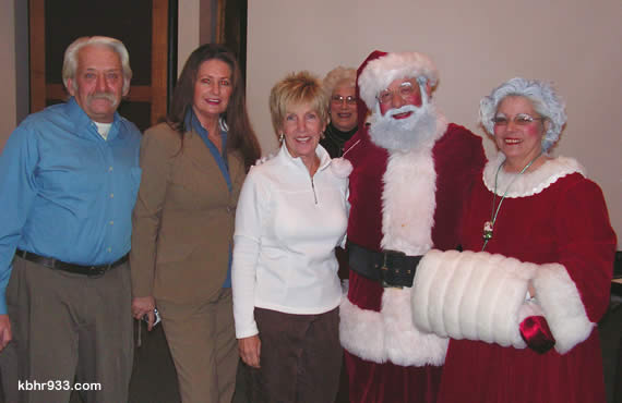 "During Christmas in the Village thank yous, Mayor Harris (in back) said, ""You made our Village spectacularly beautiful!"" Those pictured are (from left) Mike & Vicky Roney, Linda Goldsmith, Santa & Joy Claus (aka Joe & Theresa Vazquez)."