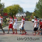 Big Bear High School Football players show off their red heels during Walk a Mile in Her Shoes!