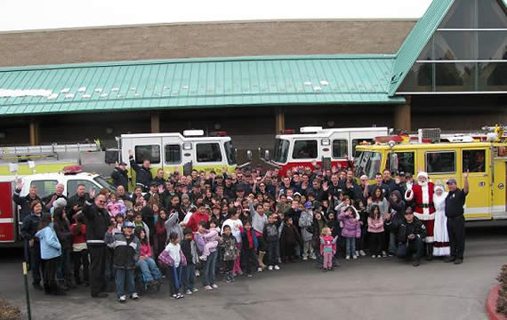 Eighty-five children, each of them singled out by their teachers for their good attitudes, were invited to join local firefighters on the 11th annual Christmas shopping spree at Kmart.
