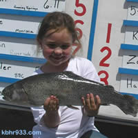Kaelee's 5.56 pound trout earned her a rod and reel, plus a trophy; grownups win cash prizes for top catches in the Jim Hall Memorial.