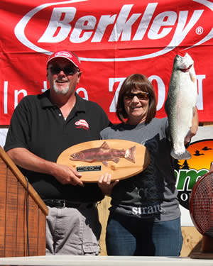 Kim Bray of Colton scored $500 for the largest catch of the day (a 5.54 lb. trout)--and another $500 for the biggest fish caught on Berkley PowerBait, as well as the fish plaque, as presented by Alan Sharp of Big Bear Marina.