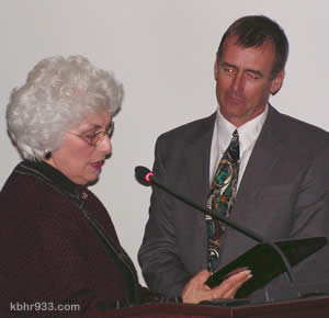 "As, at Council's last meeting in December, Liz Harris was elected mayor, at this week's meeting she presented outgoing Mayor Rick Herrick with a plaque. ""This is a surprise,"" he said. ""Thank you very much. I'm glad you're mayor."" For more on the January 11 Council meeting, see our January 12 posting."