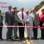 Engineers from Cal Trans, CHP, Forest Service, Assembly Member Paul Cook, and Cal Trans Director Ray Wolfe cut the Ribbon opening up Highway 330!
