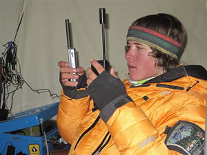 Thirteen-year-old Jordan on Everest, making a call back home to mom in Fawnskin this week.