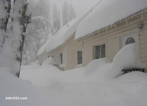24 hours later... the same houses, buried, as of Friday morning as our epic storms continue.