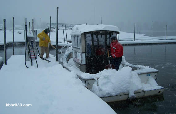 The Big Bear Municipal Water District's Lake Patrol boat needed shoveling on Thursday morning, to prevent it from swamping. Mechanical/Facility Technician Jim Weber and Lake Operations Supervisor Travis Carroll ready the boat, should it be needed for rescue operations on Big Bear Lake (that said, don't venture out on to the lake ice!)