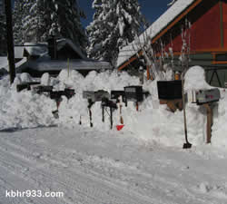Postal customers with street delivery mailboxes and cluster boxes are reminded to clear them of snow, as was done in this Big Bear City neighborhood.