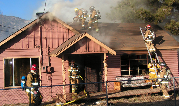 A cabin fire on Meadow Lane in Big Bear City on Saturday afternoon (11/19/2011) was quickly knocked down by the Big Bear City and Big Bear Lake fire departments.  The cabin suffered major damage.