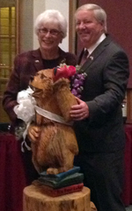 "Mayor Jahn presents Liz Harris with a ""schooled"" bear for her retirement from Big Bear Lake City Counil"